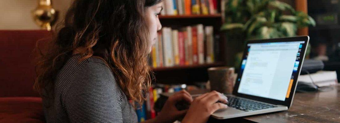 girl on laptop on desk